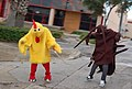 Men dressed as cockroach and chicken.jpg