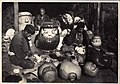 Men making Daruma by sticking paper to wooden molds (1912 by Elstner Hilton).jpg