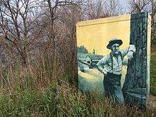 A painting of lumbermen on an electrical box in Menomonie, Wisconsin.