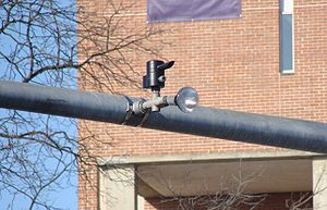Traffic signal preemption - A notifier and receiver mounted between traffic lights.