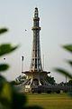 Minar-e-Pakistan through foliage.jpg