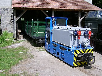 Kemence Forest Museum Railway - Electric locomotive in front of the depot, with a homemade passenger car