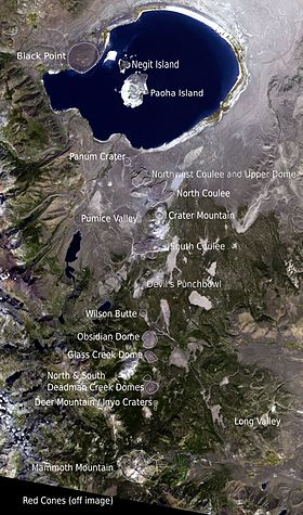 Overhead view of a large lake with three islands. Small mountains extend south. Each has a label.