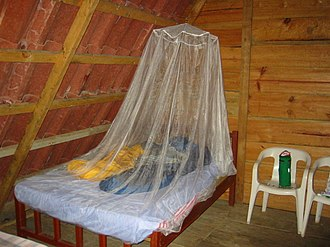 Mosquito net - Ceiling hung mosquito netting.