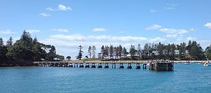 Motuihe Island - The wharf on the southern side of the island, with the bay behind filled with day-tripper boats.