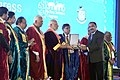 Narendra Modi felicitating the awardees at the inauguration ceremony of the 103rd Session of Indian Science Congress, in Mysuru. The Governor of Karnataka, Shri Vajubhai Rudabhai Vala and other dignitaries are also seen (3).jpg