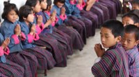 File:Near Tashi Yangtse, elementary school, prayer after class.webm
