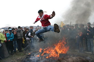 Newroz as celebrated by Kurds - It is a tradition to jump across a fire at Newroz.