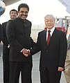 Nguyen Phu Trong being received by the Minister of State for Civil Aviation, Shri K.C. Venugopal, on his arrival at the Air Force Station, Palam, in New Delhi on November 19, 2013.jpg