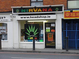 "Head shop - The ""Nirvana"" head shop in Dublin, Ireland. A large image of a cannabis leaf adorns the front of the store."