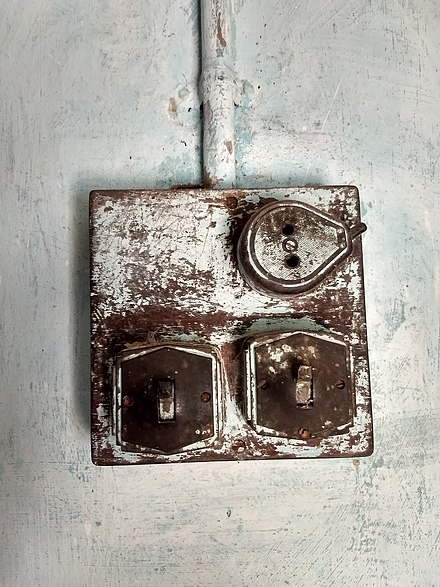Old tumbler switch composed of Bakelite Old Bakelit light switches and socket.jpg