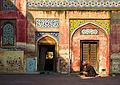 Old man reciting Quran at wazir khan mosque.jpg