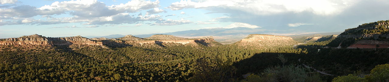 Panorama taken from the Anderson Overlook with mesas, canyons, and pine trees