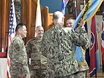 Outgoing Joint Detention Group Commander, Army Col. Stephen E. Gabavics, hands off the JDG guideon to Joint Task Force Guantanamo Commander, Navy Rear Admiral John C. Ring - 180627-Z-PV458-0032.JPG