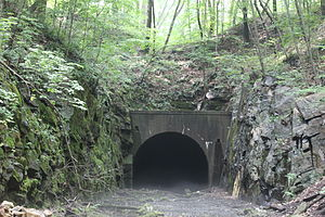 Lackawanna Old Road - Oxford Tunnel's eastern portal, August 2011; low overhead clearances and increasing traffic forced the railroad to install gauntlet track in the tunnel, creating a bottleneck that was ultimately eliminated by the building of the Lackawanna Cut-Off