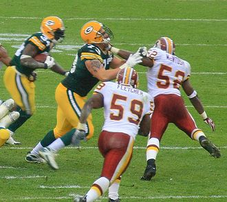 Comparison of American football and rugby union - An American football professional game in 2007 showing the ball carrier running behind his offensive lineman; he may lateral to avoid a tackle, but this is exceptionally rare as possession is generally guaranteed and a lateral that is fumbled or not recovered by a teammate is likely to result in a turnover