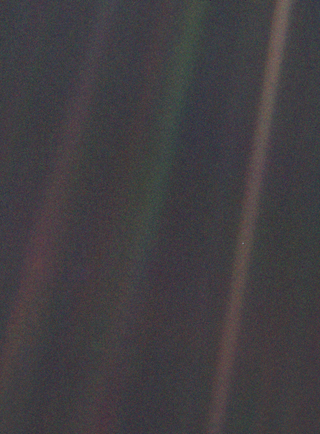 Dark grey and black static with coloured vertical rays of sunlight over part of the image. A small pale blue point of light is barely visible.