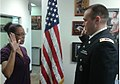 Paloma Belle Irizarry of Brandon, Fla., receives the oath of office from U.S. Army Capt. Steven Fields , at the Tampa Medical Recruiting Station, March 23, 2013 130323-A-ZZ999-001.jpg