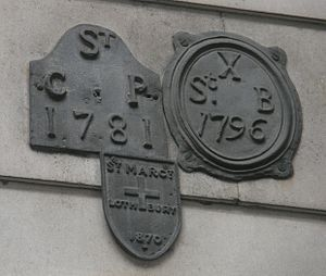St Bartholomew-by-the-Exchange - Parish boundary mark on wall of the Bank of England