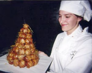 Pastry chef - A professional pastry chef presents a French croquembouche.