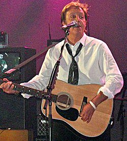 "Paul McCartney performing ""Blackbird£ at the BBC Electric Proms in 2007"