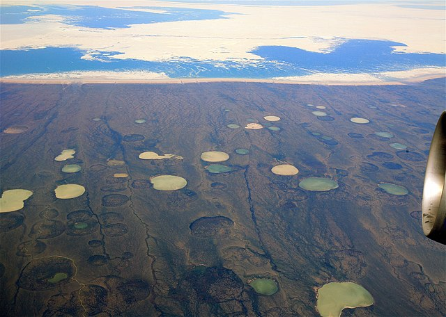 Photo shows what appears to be permafrost thaw ponds in Hudson Bay, Canada, near Greenland. (2008) Global warming will increase permafrost and peatland thaw, which can result in collapse of plateau surfaces. Permafrost thaw ponds in Hudson Bay Canada near Greenland.jpg
