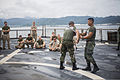 Philippine Marine Corps Tech. Sgt. Ernesto Elijan Jr., second from right, a martial arts instructor, and a fellow marine demonstrate proper blade handling techniques to U.S. Marines assigned to Bravo Company 140627-M-MP631-027.jpg