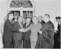 Photograph of President Truman shaking hands with Tom Clark in the White House Rose Garden, on the occasion of... - NARA - 200162.tif
