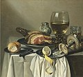 Pieter Claesz - Still life with ham, lemon, a roll, a glass of wine, and others on a table 2009 NYR 02237 0042 000.jpg