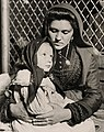 "Portrait of an Italian mother and child just arrived at Ellis Island in 1905, NMFF.000705 ""Peace"" (6620099783) (cropped).jpg"