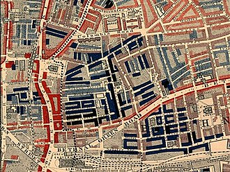 "Slum - Part of Charles Booth's poverty map showing the Old Nichol, a slum in the East End of London. Published 1889 in Life and Labour of the People in London. The red areas are ""middle class, well-to-do"", light blue areas are ""poor, 18s to 21s a week for a moderate family"", dark blue areas are ""very poor, casual, chronic want"", and black areas are the ""lowest class...occasional labourers, street sellers, loafers, criminals and semi-criminals""."