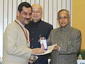 Pranab Mukherjee presenting the medal to the Minister of State (Independent Charge) for Youth Affairs & Sports, Shri Jitendra Singh.jpg