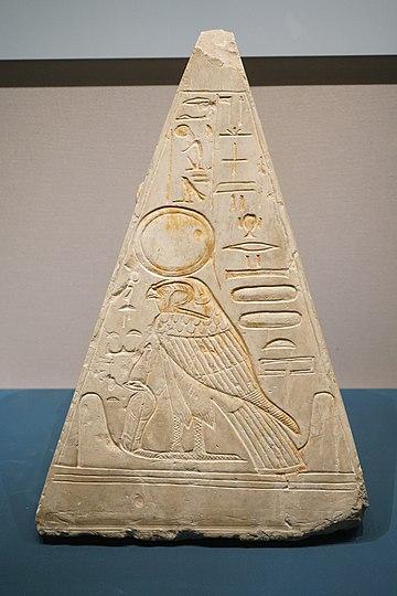 Pyramidion of Khonsu, with the image of Ra-Horakhty in the middle. Pyramidion of Khonsu font.jpg