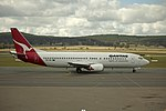 Qantas (VH-TJK) Boeing 737-476 on the tarmac at Canberra Airport.jpg