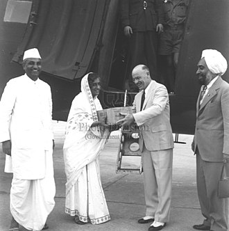 Amrit Kaur - Ninety-three cases of penicillin, a gift from the Canadian Red Cross to India arrived at New Delhi in a special plane from Canada on 17 October 1947. Presenting the gift to Amrit Kaur, the then Health Minister in the Government of India at the Palam aerodrome. Jivraj Narayan Mehta, Director General of Health Services appears on the left and standing on the right is Sardar Balwant Singh Puri of the Indian Red Cross.