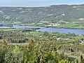 Randsfjorden Lake, Fluberg bru (road bridge), Rødnes, Haga, etc. Søndre Land municipality, Norway. Morning sun, forests, hills. View from Granum Gård boarding house 2021-06-01 IMG 1178.jpg