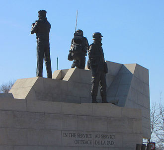 Peacekeeping Monument - Closeup of figures and inscription
