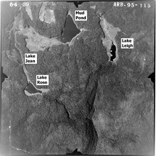 "Black and white aerial photo of four lakes (labeled per the caption) with a deep Y-shaped valley at bottom. The photo is labeled at top: ""6-4-39"" and ""ARB-95-115""."