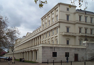 Carlton House Terrace - The West Terrace. Numbers 8 and 9, formerly the German Embassy and now the home of the Royal Society, are the tall houses at the near end of the terrace.