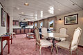 S.S. Legacy - Owner's Suite Entertainment Area.jpg