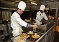 Sailors cook in a military competition. (8574828196).jpg