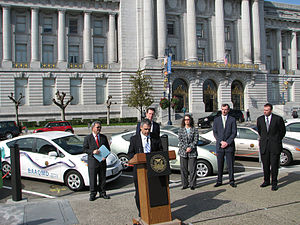 Plug-in electric vehicles in the United States - San Francisco Mayor Gavin Newsom at the opening of the public plug-in charging stations in front of San Francisco City Hall in 2009