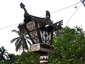 Kaharingan - Sandung of Dayak Pesaguan people in Ketapang Regency, West Kalimantan.  Note a sculpture of a dragon above it