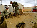 Seabees and sand bags fight flooding in Sigonella 120222-N-OM828-010.jpg