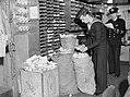 Seamen sorting out waste paper on board a battleship, September 1942. A11416.jpg