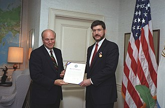 David Addington - Addington is presented with an award by then Defense Secretary Dick Cheney in 1992