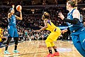 Seimone Augustus is guarded by Essence Carson as Lindsay Whalen gets open for a pass in the Minnesota Lynx vs Los Angeles Sparks game.jpg