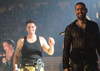 Shane Lynch - Shane Lynch (right) on stage with Keith Duffy (centre) and Stephen Gately (left)