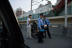 A driver get his scooter checked. The police i...