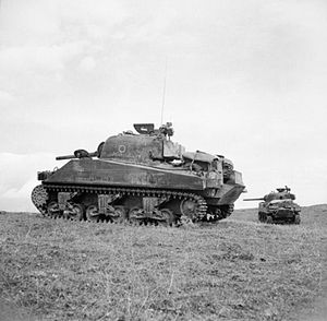 46th (Liverpool Welsh) Royal Tank Regiment - Sherman tanks of the 46th Royal Tank Regiment provide fire support for men of the 1st Battalion, Loyal Regiment (North Lancashire) at Anzio, Italy, 25 January 1944.